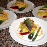 Pan-fried sea bass fillet with English asparagus and chilli, garlic & tiger prawn linguine