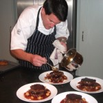 Chef Andy plating up main course