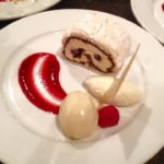Dark chocolate & cherry meringue roulade with chantilly cream, raspberry coulis & brandy ice cream