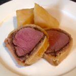 Roasted beef Wellington with dauphinoise potatoes & port wine sauce