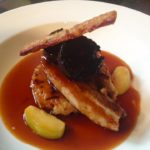 Low & slow cooked pork belly with caramelised apples, black pudding, potato rosti, cider sauce & crackling
