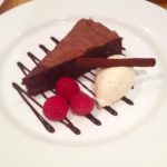 Baked chocolate truffle torte with whiskey cream