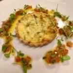 Leek & Gruyere tart, tomato & truffle dressing